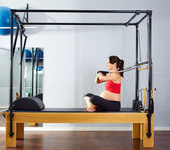 Pregnant woman pilates reformer arms exercise — Stock Photo