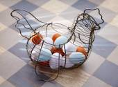 Eggs in a vintage hen shape basket — Stock Photo