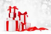 Christmas gifts with red bows — Stock Photo