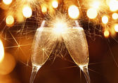 Glasses of champagne with sparklers — Stock Photo