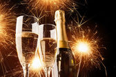Champagne with sparklers — Stock Photo