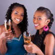 Young beautiful African womans holding a glass of champagne  — Stock Photo #55445465