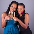 Young beautiful African womans holding a glass of champagne  — Stock Photo #55445529