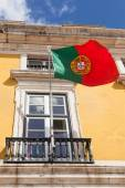 Portugal flag waving on the wind in front an administrative buil — Stock Photo