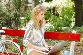 Beautiful young woman with laptop — Stock Photo
