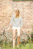 Beatuiful girl with bike — Stock Photo