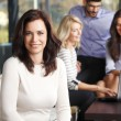 Business woman with team — Stock Photo #65354595
