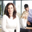 Business woman with team — Stock Photo #65354733