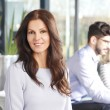 Business woman with team — Stock Photo #65354795