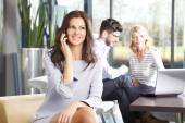 Beautiful business woman with phone — Stock Photo
