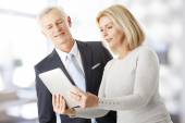 Business people with digital tablet — Stock Photo