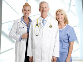 Doctors and nurse in clinic — Stock Photo