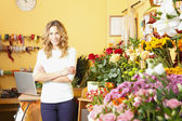 Woman in flower shop — Foto de Stock