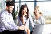 Teamwork at office near laptop — Stock Photo
