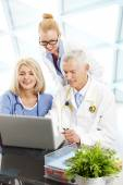 Doctors and nurse near laptop — Stock Photo