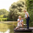 Senior couple relaxing and fishing — Stock Photo #77833394