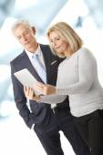 Business partners with digital tablet — Stockfoto