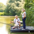 Senior couple relaxing and fishing — Stock Photo #78067142