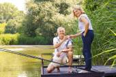Happy senior couple fishing — Stock Photo