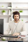 Young businessman with headphone — Stockfoto