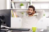 Relaxing professional near computer — Stockfoto