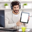Young businessman listening music — Stock Photo #78646150