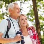 Senior people enjoying a walk together. — Stock Photo #78885992