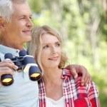 Senior people enjoying a walk together. — Stock Photo #78886370
