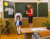 Pupil and teacher — Stock Photo