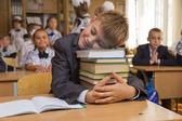 Boy fell asleep hugging the book — Stock Photo