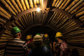 Dark eerie mining tunnel — Stock Photo