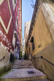 Typical narrow and convoluted streets with steps of Lisbon, Portugal — Stock Photo