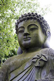 Buddha statue on a park. — Stock Photo