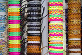 Many various leather and textile bracelets — Stock Photo