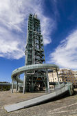 Deactivated refinery complex, distillation tower — Stock Photo