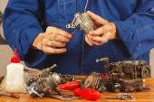 Master repairing parts of the automobile engine in workshop — Stock Photo