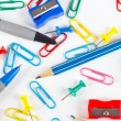 Pencil, pen, paperclips, sharpeners and thumbtacks on white desktop — Stock Photo #55831673