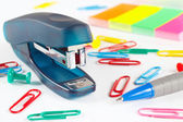 Stapler and multicolored stationery on white desktop closeup — Stock Photo