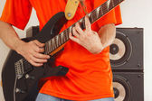 Hands of man playing the electric guitar close up — Stock Photo