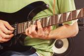 Hands of a rock guitarist playing the electric guitar — Stock Photo