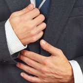 Stylish man straighten his business suit closeup — Stock Photo