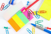 Multicolored office stationery on white desktop closeup — Foto Stock