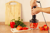 Hands chefs are going to shred red pepper in blender — Stok fotoğraf