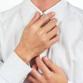 Man straighten collar of his bright shirt closeup — Stock Photo