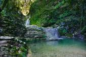Wonderful waterfall among the rocks in mountain forest — Stock Photo
