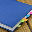 Business diary with a colored bookmarks — Stock Photo #73171201