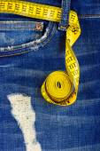 Measuring type with jeans — Stock Photo