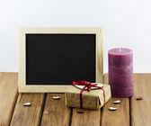 Gift box and hearts — Stock Photo