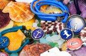 Colorful seashells and jewelery — Stock Photo