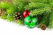 Green christmass ball with fur-tree — Stock Photo